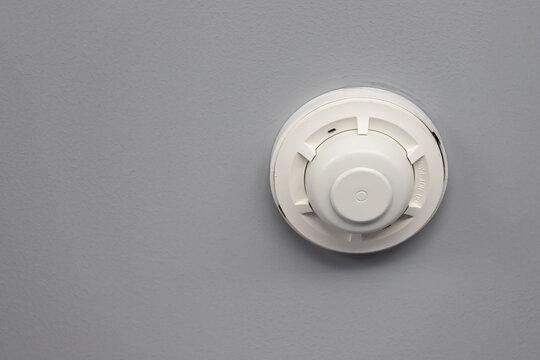 smoke detector on grey ceiling.