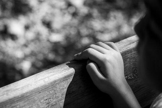 Child's dirty hand on the wood