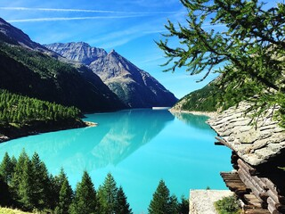 Obraz Panoramic View Of Lake And Mountains Against Blue Sky - fototapety do salonu