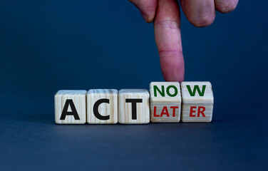 Act now, not later symbol. Male hand turns wooden cubes and changes words 'act later' to 'act now'. Business and act now or later concept. Beautiful grey background, copy space.