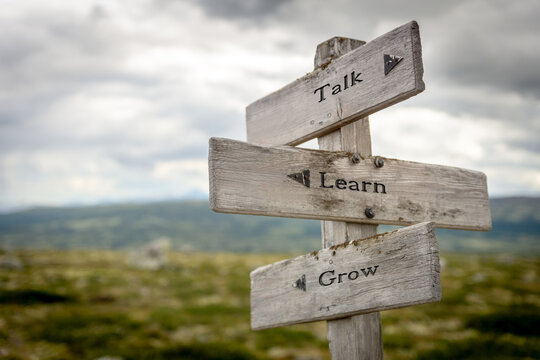 talk learn grow text on wooden signpost outdoors in nature
