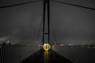 Obraz Illuminated Suspension Bridge At Night - fototapety do salonu