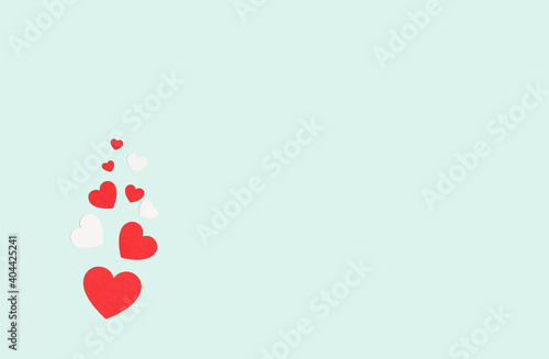 Background with red and white hearts with free space for text on pastel blue background. Valentines day concept. Mother's Day concept. Greetings. Copy space. Flat lay, top view.