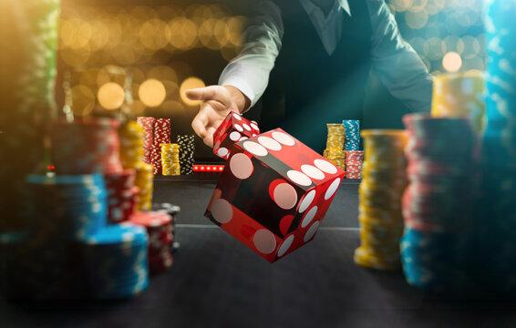 Man gambling at the craps table at the casino