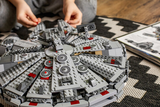 The boy collects a spaceship from the Lego Millennium Falcon.. From the movie Star Wars.