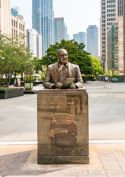 Chicago, Illinois, USA - August 24, 2014: Jack Brickhouse bronze Memorial statue, a famous sports announcer and reporter on Michigan Avenue in Chicago Downtown.