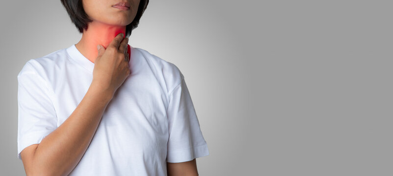 An Asian woman puts a hand on her neck. , From the symptoms of GERD