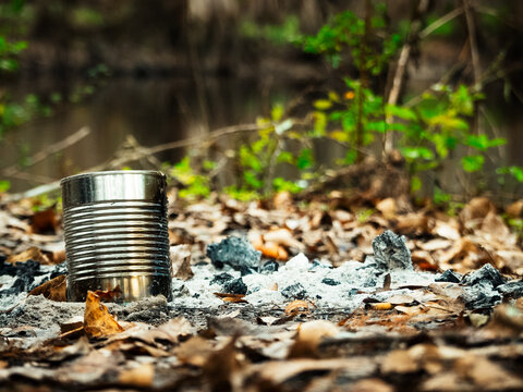 Can left by river. Abandoned campfire. Pollution. Leave no trace. Pick up your trash.