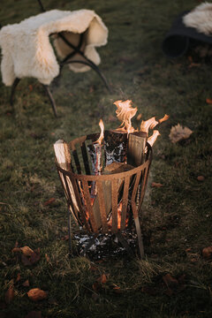 Fire basket with burning wood