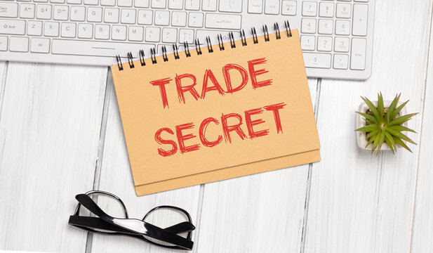 Trade Secrets written on notebook with charts.