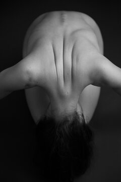 beautiful curve lines on the back from the shoulder blades and shoulders of a naked girl. Space for text
