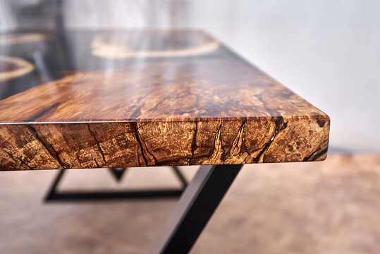 Texture of a wooden table with epoxy resin.