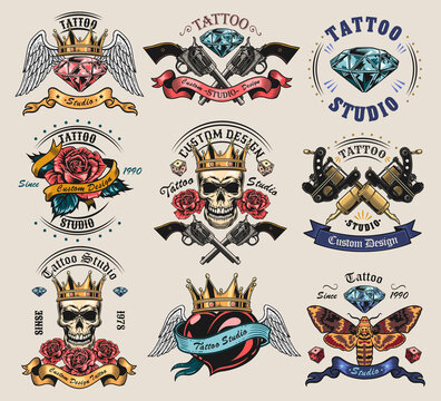 Vintage tattoo studio emblems set. Retro logos with cross guns, skulls in crown, skeleton, rose isolated vector illustration collection. Tattoo studio and design elements concept