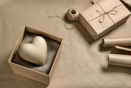 Papier mache heart in a cardboard box.
