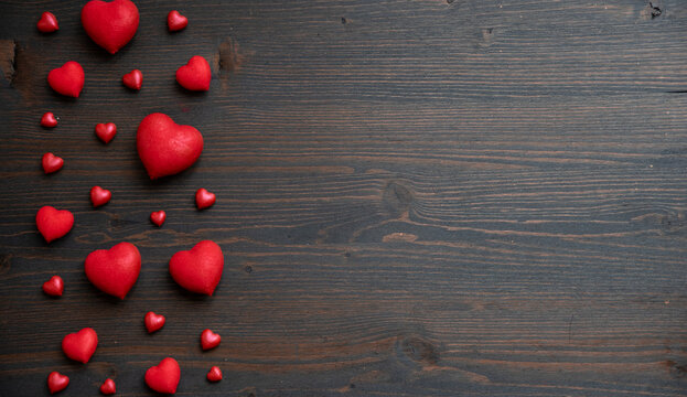 Valentines day wooden background with red hearts