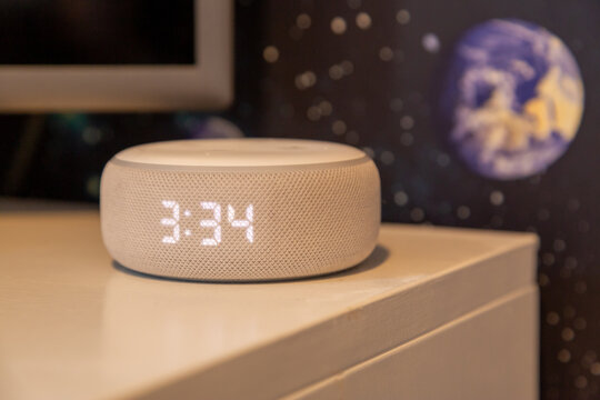 01-11-2021 Portsmouth, Hampshire, UK An amazon echo Dot or amazon Alexa on a table it a child's bedroom a common smart home device