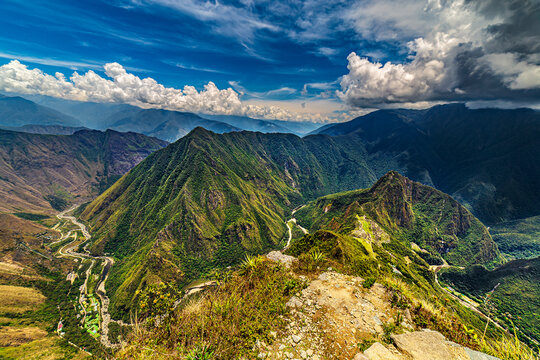 Peru, Cusco Region. Historic Sanctuary of Machu Picchu (right side) seen from Machu Picchu Mountain. There are Huayna Picchu raised above the Inca city, Urubamba River below and Hidroelectrica in left