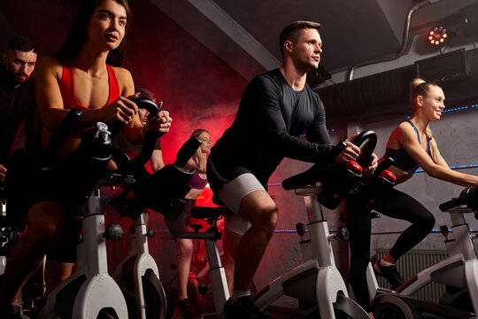 people exercising, legs cardio training on bicycle in fitness gym, for good healthy. bodybuilder, lifestyle, exercise fitness, workout and sport training concept