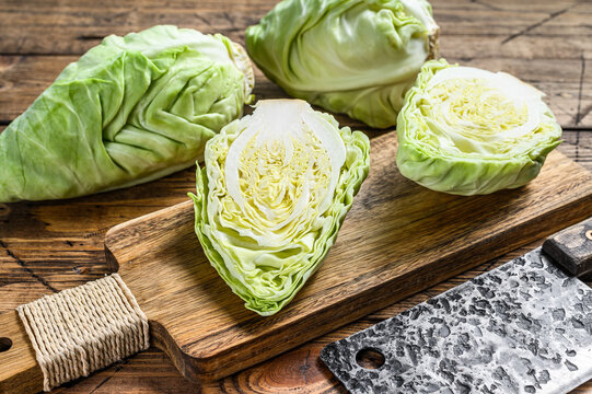 Fresh Green pointed cabbage. Wooden background. Top view