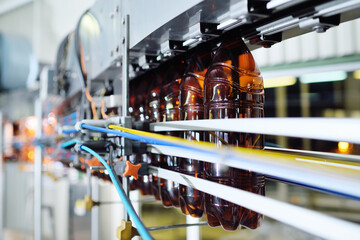 Industrial production of plastic bottles for low-alcohol beverages, soda and sunflower oil. Empty...