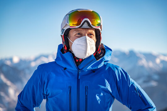 Portrait of a male skier wearing a FFP2 mask