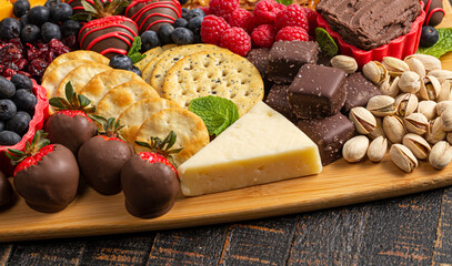 A Chocolate Covered Strawberries and Cheese Sweet Charcuterie Board on a Rustic Wooden Table