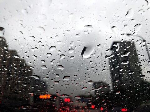 Full Frame Shot Of Wet Window During Rainy Season