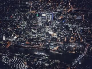 Aerial View Of Illuminated City Buildings At Night - fototapety na wymiar