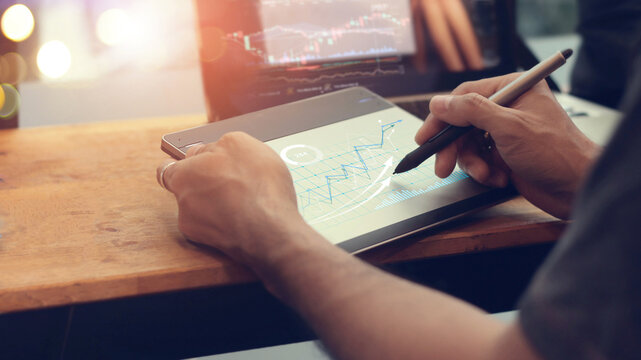 Businessman draw graph growth on digital board, Strategy and planning of business, Financial, Stock market and data exchange.