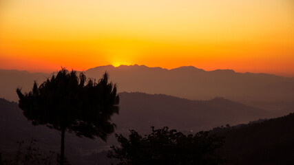 Obraz Silhouette Trees On Mountain Against Romantic Sky At Sunset - fototapety do salonu