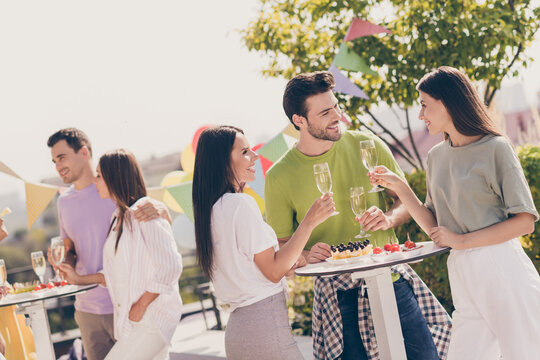 Photo of young attractive friends drink champagne eat snacks celebrate chill chat smile enjoy summer party