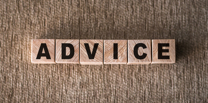 The word ADVICE is written on wooden blocks on a brown background.