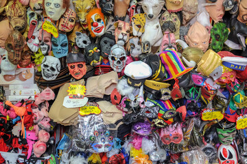Fototapeta Multi Colored Toys And Face Masks For Sale At Market Stall obraz