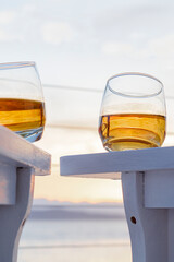 Low Angle View Of Whiskey On Table Against Sky During Sunset