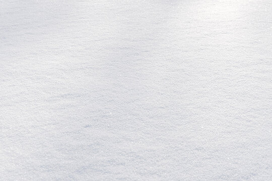 White clean shiny snow background texture. fresh snow  seamless texture. snowy surface closeup