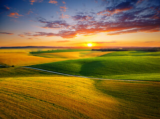 Wall Mural - Attractive aerial photography of agrarian land in sunlight in the evening.