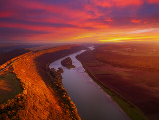 Beautiful top view of winding river in sunset. Scenic image of drone photography.