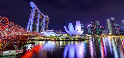 Fototapeta Illuminated Modern Buildings In City At Night