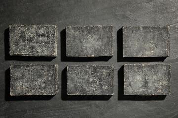 Wall Mural - Natural tar soap on black background, flat lay
