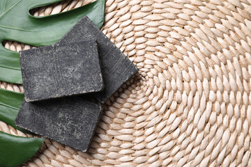 Wall Mural - Natural tar soap on wicker mat with green leaf, flat lay. Space for text
