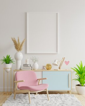 Poster mockup with vertical frames on empty white wall in living room interior with pink velvet armchair.