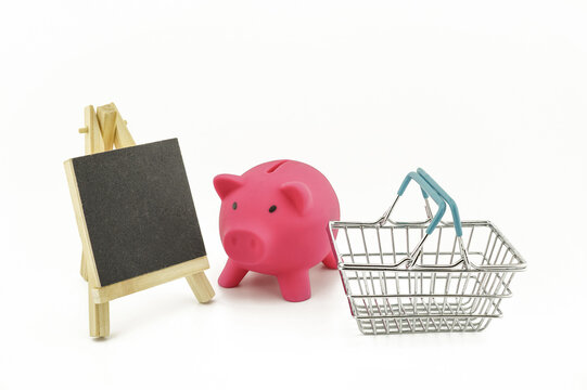 Pink pig saver and wire shopping basket
