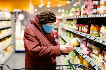 Old senior woman wear medical mask, protection against pandemic coronavirus disease. 90 years...