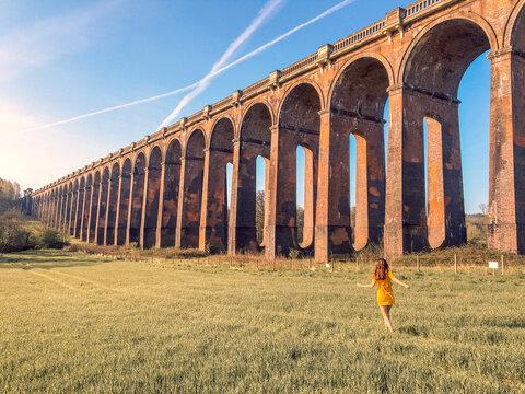 Woman walks near the bridge