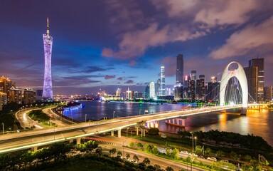 Obraz Illuminated Bridge And Buildings Against Sky At Night - fototapety do salonu