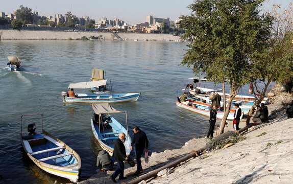 People disembark boats they use to travel between the banks of the Tigris river to avoid the traffic jams in Baghdad