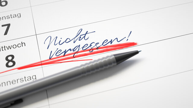 calendar with a red pen and the word do not forget in german language