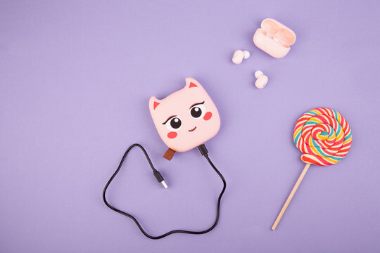 Power bank pink with pink headphones for children