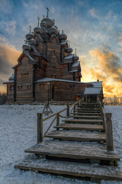 Restored orthodox wooden Twenty-five-headed Church of the Intercession of the Blessed Virgin Pokrovskaya at sunny winter day. St.Petersburg suburb, Russia.