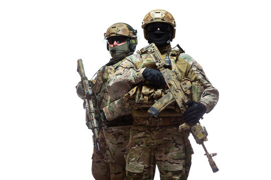 Portrait of two soldiers in camouflage, unloading vests, helmets and balaclavas, one standing behind the other, armed with machine guns waiting for the command to attack, isolated on white background